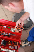 Electrician choosing a tool — Stock Photo