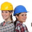 Stock Photo: Women in hard hats with carpenter