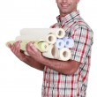 Man carrying rolls of wall-paper — Stock Photo #14648131