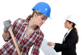 Labourer working beside an engineer — Stock Photo