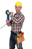 Cheerful manual worker holding angle grinder — Stock Photo