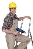 Manual worker climbing ladder — Stock Photo