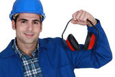 Construction worker with ear defenders — Foto Stock