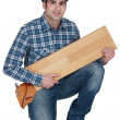 Builder with wooden flooring — Stock Photo