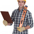 Royalty-Free Stock Photo: Worker holding spirit level and clip-board