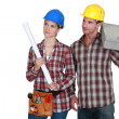 Stock Photo: Tradesmand tradeswomlooking sideways