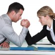 Arm wrestling between male and female colleagues — Stock Photo #14658659