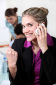 Woman closing a deal over the telephone — Stock Photo
