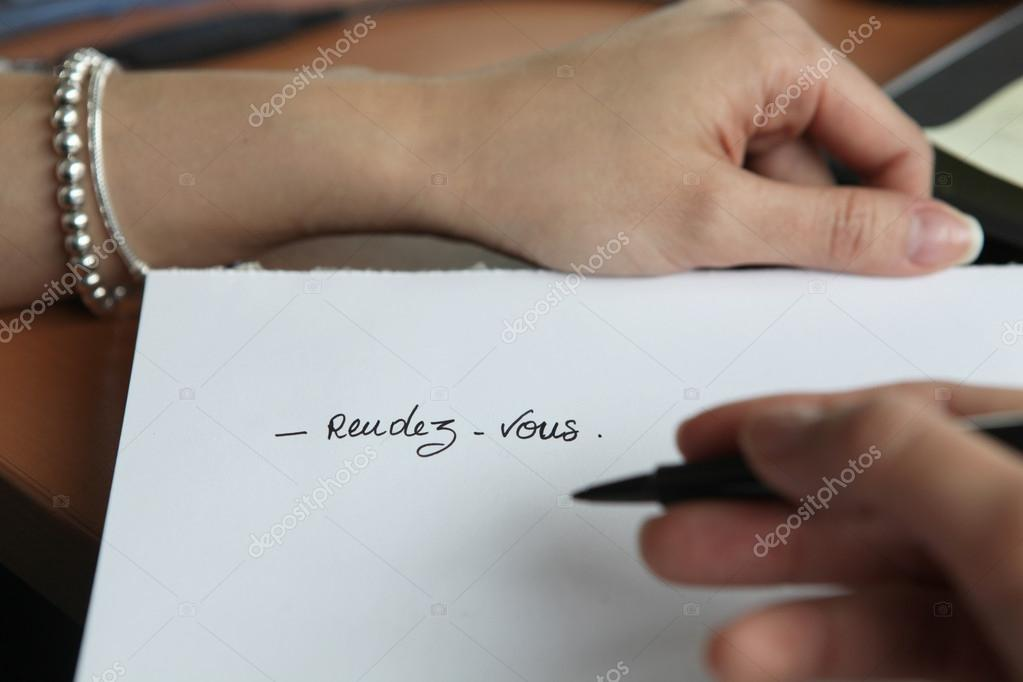 Woman writing date of an appointment — Stock Photo #14652541