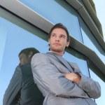Businessman standing next to window — Stock Photo