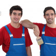 Two painters wearing matching outfits — Stock Photo #14663605