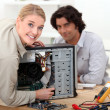 Stock Photo: Technicifixing computer