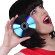 Stock Photo: Womsticking cd near her ear