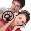 Email symbol and woman listening to music — Stock Photo #14669735