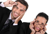 Businessman and woman in glasses — Stock Photo