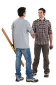 Two carpenters shaking hands — Stock Photo