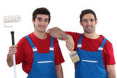 Two painters wearing matching outfits — Stock Photo