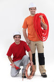 Duo of cheerful plumbers — Stock Photo
