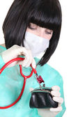 Nurse using stethoscope on purse — Stock Photo