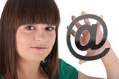 "Young woman showing an ""@"" Godreau_Lea_140410 — Stock Photo"