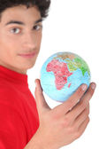 Dark-haired boy with globe — Stock Photo