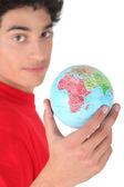 Dark-haired boy with globe — Stock Photo