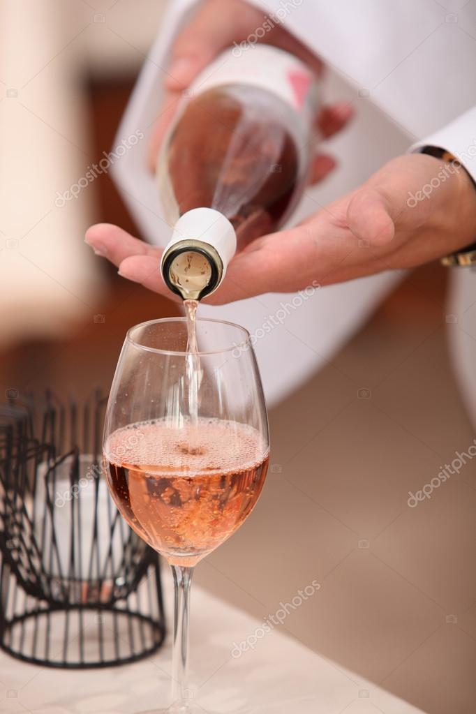 Waiter pouring sparkling wine — Stock Photo #14665475