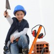 Little boy dressed as builder — Stock Photo