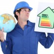 Stock Photo: Manual worker promoting reducing carbon emissions.
