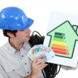 Craftsmholding energy consumption label — Stock Photo #14674847