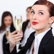 Stock Photo: Females coworkers drinking champagne.