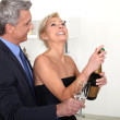 Couple drinking champagne — Stock Photo #14678281