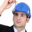 Man with blue helmet — Stock Photo #14678525