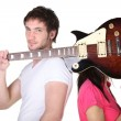 Young couple with a guitar and microphone — Stock Photo