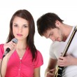 Stock Photo: Female singer and male guitarist