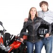 Couple stood with motorcycle - 图库照片