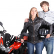 Couple stood with motorcycle - ストック写真