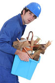 A weird man carrying scraps. — Stock Photo