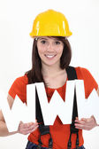 Tradeswoman embracing technology — Stock Photo