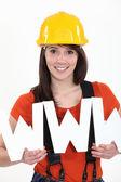Tradeswoman embracing technology — Stock Photo