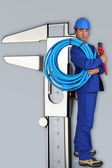 Plumber next to giant calliper — Stock Photo