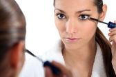Woman applying eye make-up — Stock Photo