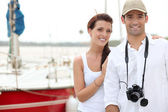 Couple stood by port — Stockfoto