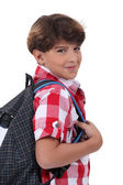 Portrait of schoolboy with satchel — Stock Photo