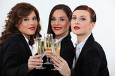 Women celebrating with a glass of wine — Stock Photo
