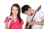 Female singer and male guitarist — Stock Photo