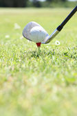Closeup of a golf ball, club and tee — Stock Photo