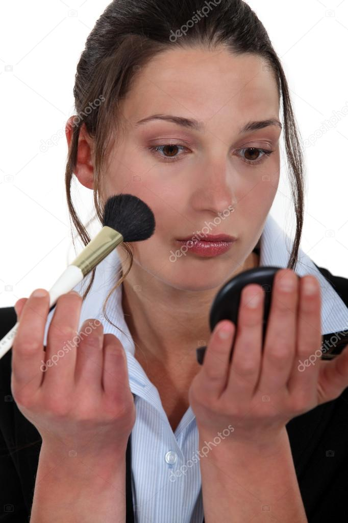 Woman applying blusher — Stock Photo #14676971