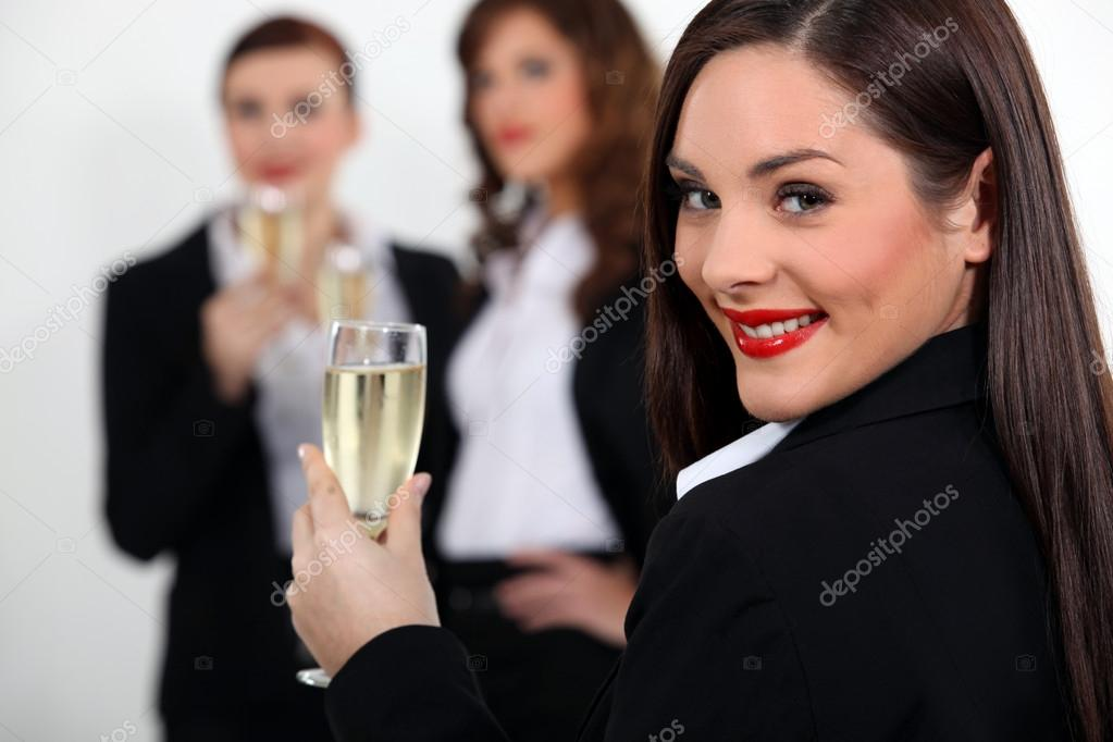Three business women drinking sparkling wine — Stock Photo #14677969