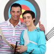 Stock Photo: Boy receiving archery trophy